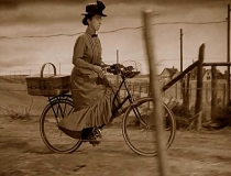 The Wicked Witch of the West on her bicycle