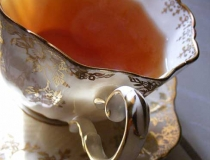 Tea in gold and white scalloped Paragon teacup