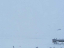 Two hours later, the same view of Polson Bay in Flathead Lake, through a blizzard