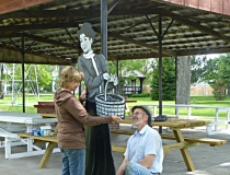 Taylor, Nebraska, artist Marah Sandoz putting up a Villager