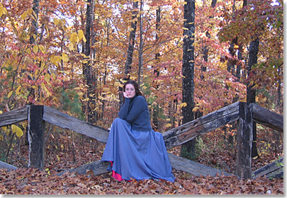 Christy McDougall sitting on a fence, Missouri autumn