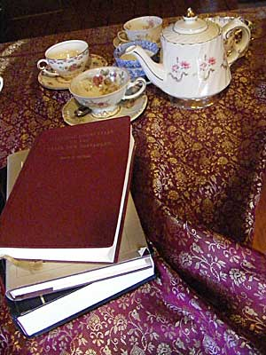 A teapot named Claudia, teacups, and Greek study books.
