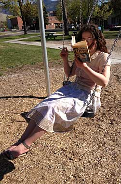 This is me, gently swinging and reading. With a pen, for underlining and making notes. And a photographer.